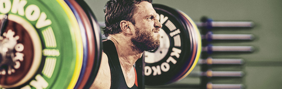 Dmitry Klokov lifting Barbell and Bumpers